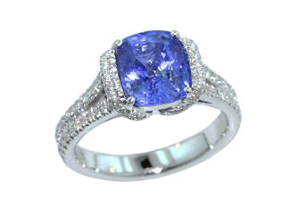Cushion sapphire engagement ring with custom made partial halo
