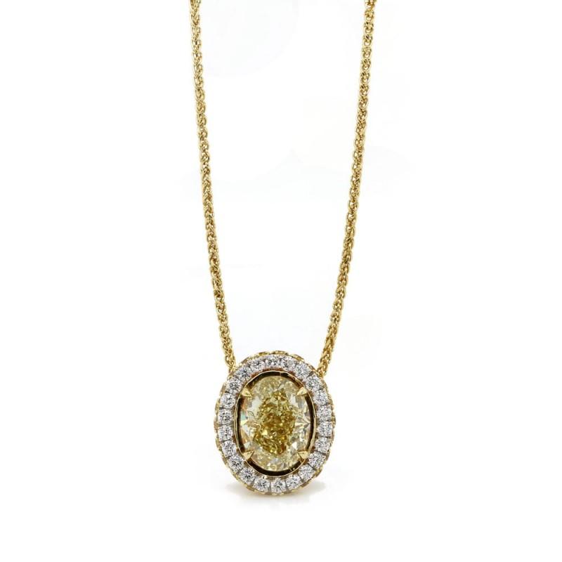 1.5ct oval Fancy Yellow diamond halo pendant