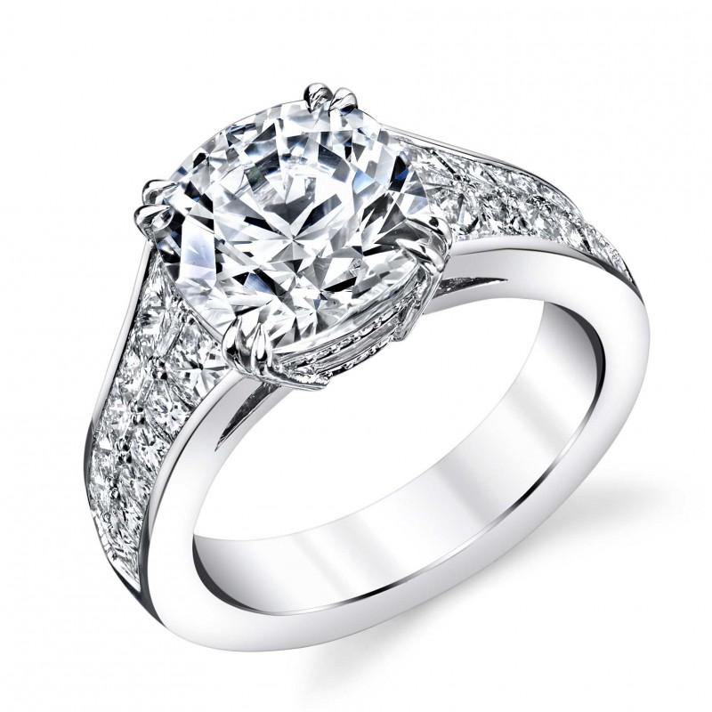 Custom made platinum Cushion center with princess cut diamond sides engagement ring