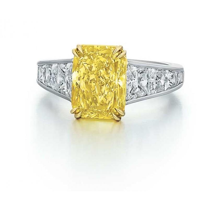 Radiant cut Fancy Yellow Diamond ring