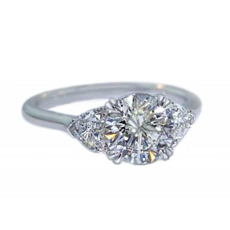 Three-stone round and heart diamond platinum ring