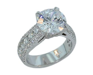 Three-row wide pave' and channel set diamond ring