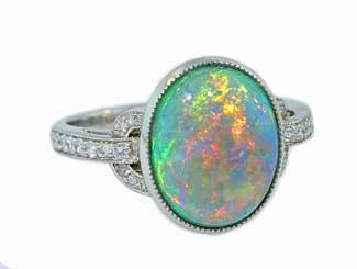 Bezel set black opal and pave' diamond ring