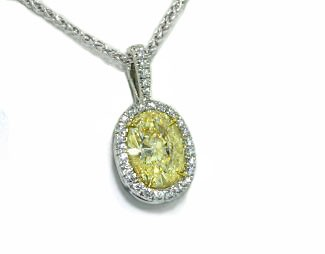 Light yellow oval diamond pave' halo pendant