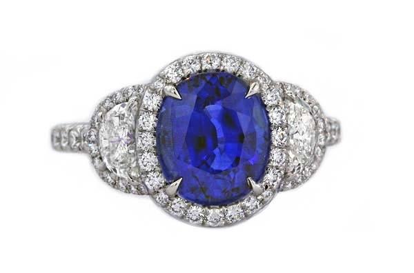 Sapphire and half-moon diamond Ring
