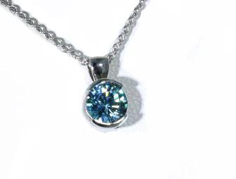 Blue zircon half bezel pendant in white gold