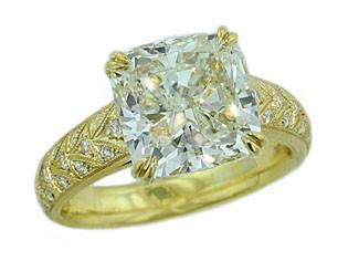 Custom made 5.09ct cushion diamond 18kyg fancy bead set ring