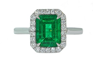 Custom made 2 carat emerald cut Emerald pave halo ring
