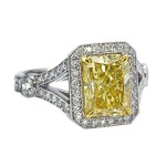 Fancy lt yellow 3.11ct radiant diamond split shank