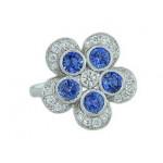 Blue sapphire and diamond bezel flower ring