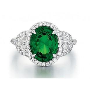 Custom Tsavorite ring with half moon diamonds