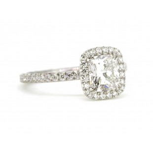 Custom made platinum Bouquet style diamond halo engagement ring