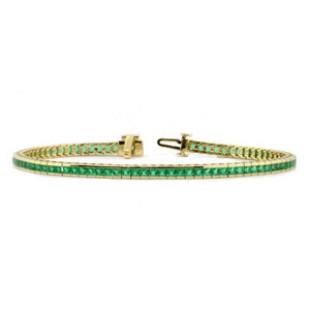 Yellow gold channel set emerald bracelet