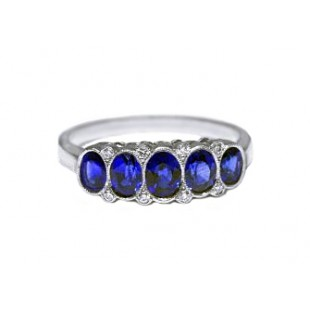 Five stone oval blue sapphire and diamond ring