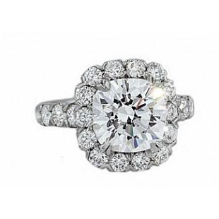 Prong set diamond halo diamond platinum ring