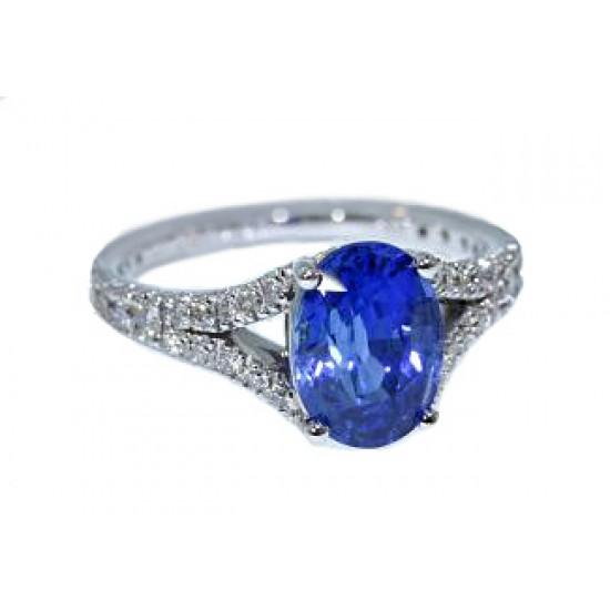 Blue sapphire oval split shank pave diamond ring