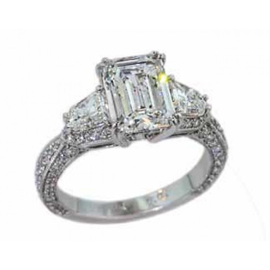 Emerald cut diamond with trapezoid shaped sides pave diamond ring