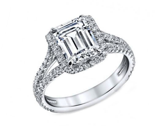 Emerald cut diamond engagement ring with partial halo