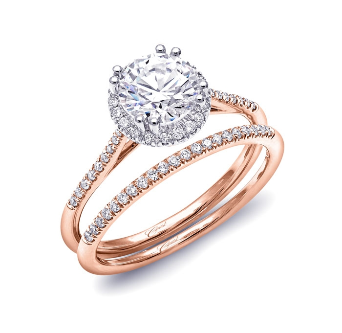 Delicate round diamond halo rose gold engagement ring